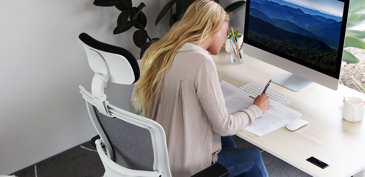 Woman seated working at desk