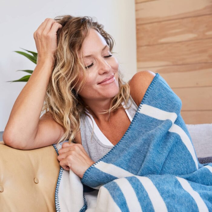 woman wrapped in blue elements blanket