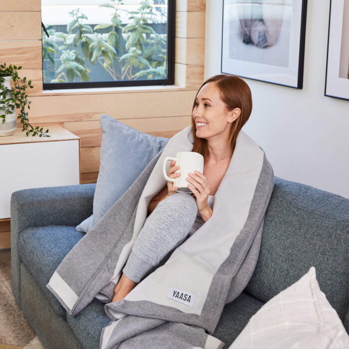 woman smiling wrapped in infinity blanket
