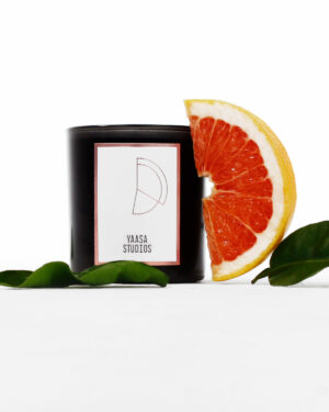 candle with grapefruit slice