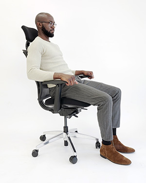 Man seated in desk chair