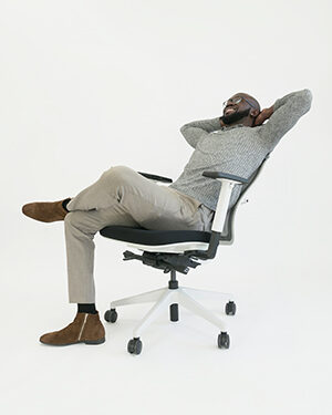 Man lounging in desk chair