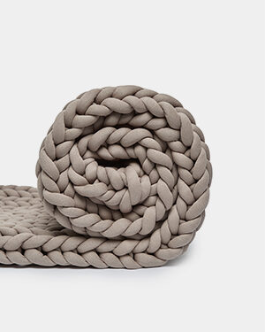 Rolled knit weighted blanket sand color